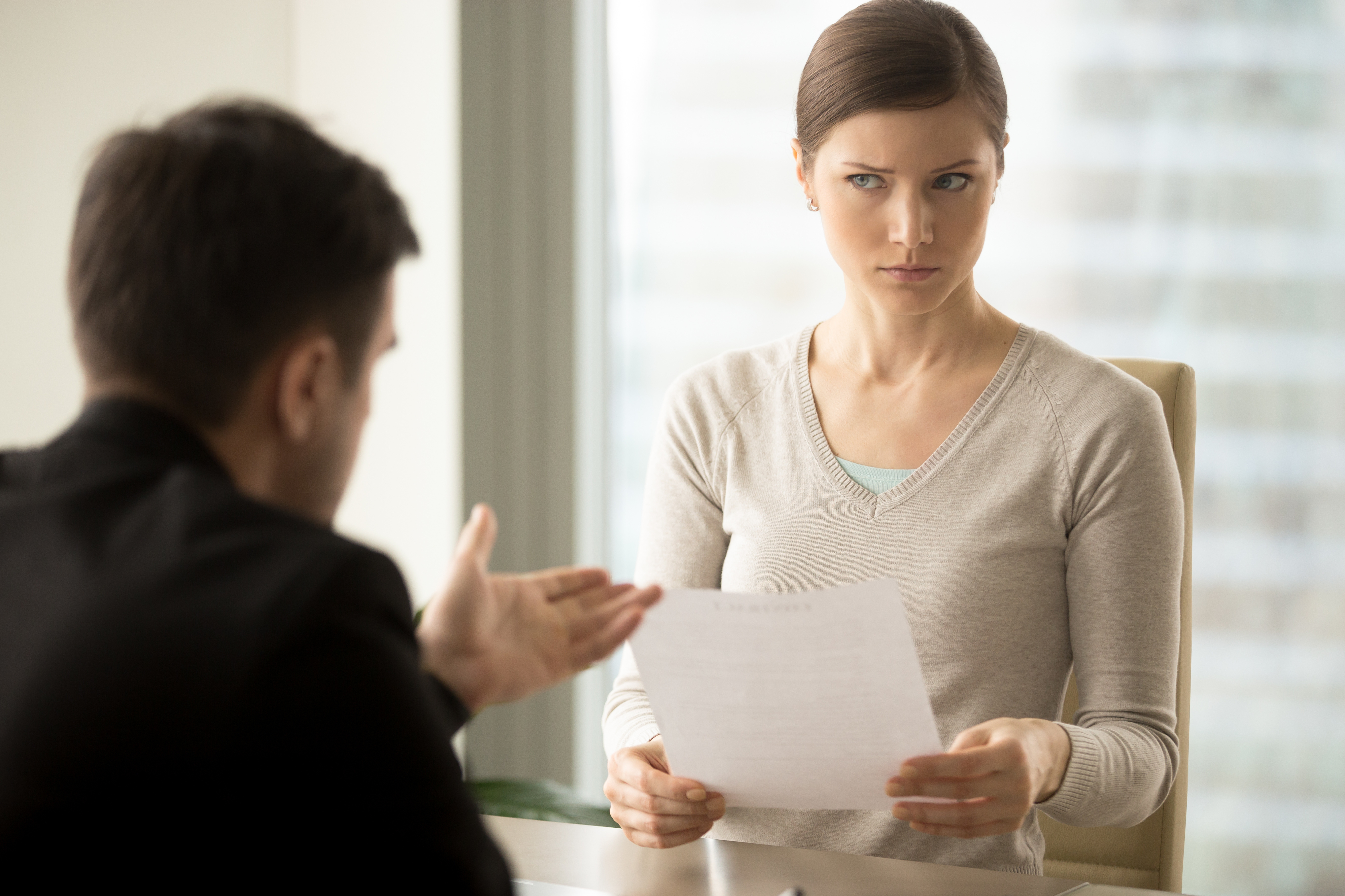 Manager trying to convince doubtful female client